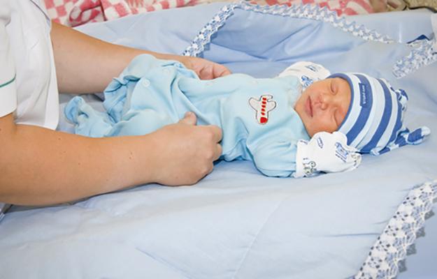 Одевание новорожденного